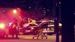 Paramedic pulls stretcher out of ambulance - stock footage