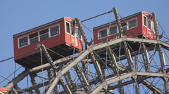 Closeup Viennese giant wheel red cabin stop rotate tourist people admire Vienna  Stock Footage