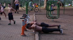 Two guys working out at Ibirapuera Park in Sao Paulo, Brazil. Stock Footage