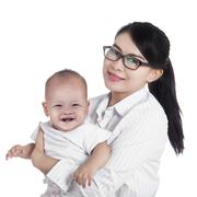 asian businesswoman and her baby - stock photo