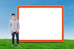 asian man and empty billboard - stock illustration