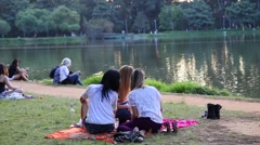 Girls take selfie at Ibirapuera Park in Sao Paulo, Brazil. Stock Footage