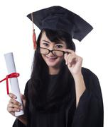 Asian student wearing graduation gown Stock Photos