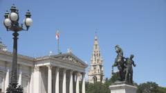 Austrian Parliament building Town Hall Tower blue sky sunny day Vienna landmark  Stock Footage