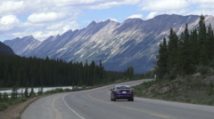 Canada Icefields Parkway mountian vista with road and car s Stock Footage