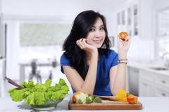 beautiful woman prepare salad - stock photo