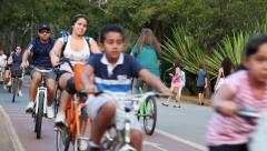 Brazilians ride a bike at Ibirapuera Park in Sao Paulo, Brazil. Stock Footage