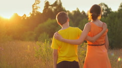 Two kids watching a sunset in nature, together, believe, lens flares - stock footage