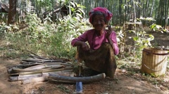 Stock Video Footage of Old and poor asian woman from local ethnic tribe in traditional clothes