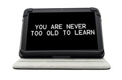 you are never too old to learn typed on a tablet screen - stock illustration