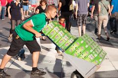 Montreal city - june 29: employee transporting several packs of heineken beer Stock Photos