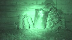 P03719 Nuisance Raccoon Feeding at Night from Garbage Can Stock Footage