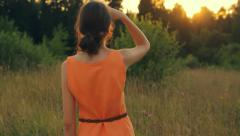 Young girl watching a sunset, looking ahead, calm atmosphere, close-up Stock Footage