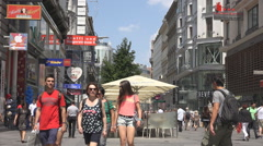 Busy pedestrian shopping street Vienna old town shop sign tourism attraction day Stock Footage