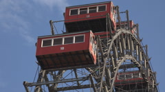 Closeup Viennese giant wheel red cabin moving rotation blue sky sunny day Vienna Stock Footage