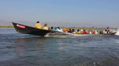 Inle Lake Boat with local people crossing the lake. Myanmar, Shan state, Intha Stock Footage