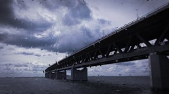 Oresunds bridge from malmo to copenhagen on rainy day Stock Footage