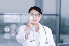 female doctor using modern technology - stock illustration