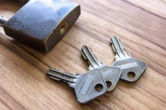 Padlock with keys on wooden Stock Photos