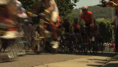 Tour de France speeds by the camera Stock Footage