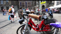 Bikes and Magna Plaza Shopping Center in Amsterdam - stock footage
