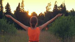 Young girl raising her hands to the sky, freedom, motivation, slow motion Stock Footage
