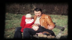 Baby and girl with father in park, bench, sunny vintage 8mm film Stock Footage
