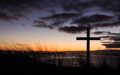 Stock Photo of sunrise salvation cross