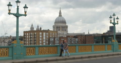 Commutors walk over Southwark bridge 4K Stock Footage