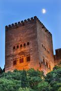 alhambra tower moon from walking street albaicin granada andalusia spain - stock photo