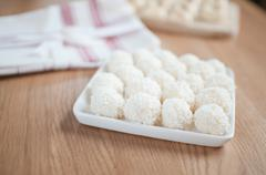 Coco balls in plate on the table Stock Photos