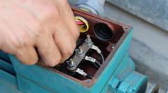 Man to repair motor machine Stock Footage