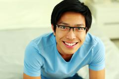 Closeup portrait of a smiling asian man Stock Photos