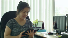 Young Asian Office Worker Working on Tablet Computer - stock footage