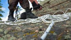 Man preparing for the ascent to the rock Stock Footage