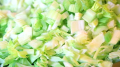 Closeup of cut green celery roots with cabbage Stock Footage