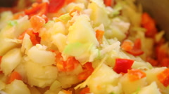 Potatoes with red sweet pepper Stock Footage