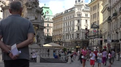 ULTRA HD 4K Busy Graben street pedestrian road Plague Column Vienna old city day Stock Footage
