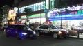 Three Police Cars At An Incident Outside Fussa Train Station Tokyo 02 HD Footage