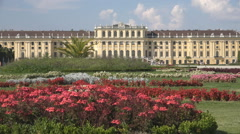 Schonbrunn Palace building garden flower sunny day Vienna landmark tourism icon Stock Footage