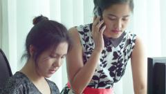Young Asian Office Workers Working Together at a Computer - stock footage