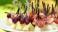 Grape and cheese canapes - stock footage