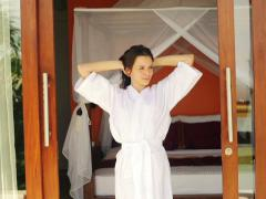 Woman in bathrobe stretching by the bedroom at home NTSC Stock Footage