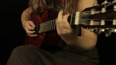 Female hands playing the guitar - stock footage