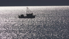 4K UHD Fishing Boat Silhouette on Sparkling Water Stock Footage