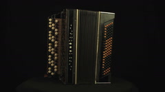 Accordion rotates on a black background loop Stock Footage