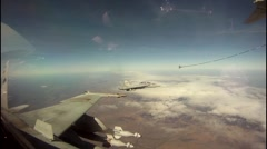 KC-130 aircraft refueling F/A-18 jets mid-air cockpit footage - stock footage