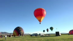 Hot Air Balloon mass Ascension takeoff farm field 4K 028 Stock Footage