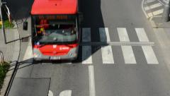 Cars drive on the road via the pedestrian crossing Stock Footage