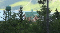 Canada Alberta Prince of Wales Hotel framed with trees Waterton Lakes NP Stock Footage